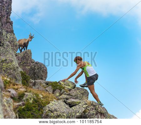 Sporty Woman Salt Rocks In The Mountains To An Ibex
