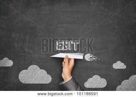 EBIT concept on blackboard with paper plane