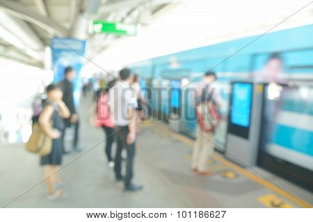 Abstract Blur Or Defocus Background Of People Waiting For Boarding Skytrain