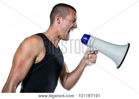 Irritated male trainer yelling through megaphone against white background