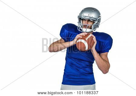 American football player holding ball white looking away against white background