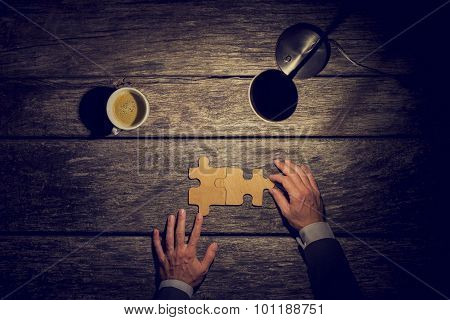 Overhead View Of Businessman Working Late At Night At His Rustic Textured Desk To Have Finnaly Came