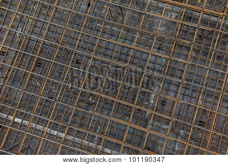 Steel bars reinforcement on construction site, top view, editable background.