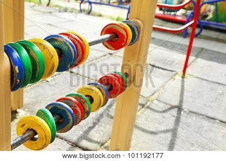 Colorful wooden rings for count on playground