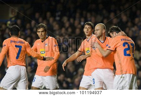 LONDON, ENGLAND. 08 December 2009. - no 27 Marcin Zewlakow playing for APOEL FC is congratulated by team mates after scoring the first goal during the Uefa Champions League match