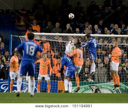 LONDON, ENGLAND. 08 December 2009. - Goalkeeper Dionisis Chiotis playing for APOEL FC punches the ball during the Uefa Champions League match, between Chelsea and Apoel Nicosia at Stamford Bridge.