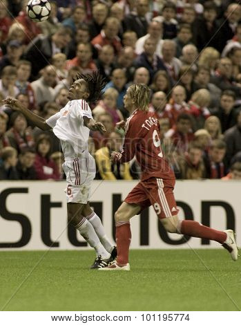 LIVERPOOL ENGLAND. 16 SEPTEMBER 2009. Luis Ramos of Debreceni VSC and Fernando Torres playing for Liverpool compete for the ball in the Champions League  match between Liverpool FC and Debreceni VSC