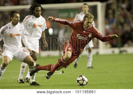 LIVERPOOL ENGLAND. 16 SEPTEMBER 2009. Lucas Leiva playing for Liverpool is tripped by Leandro playing for Debreceni VSC in the Champions League Group E, match between Liverpool FC and Debreceni VSC