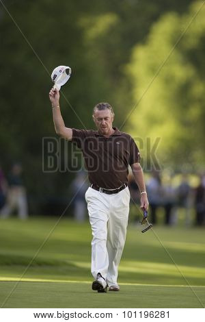 WENTWORTH, ENGLAND. 23 MAY 2009. Miguel Angel JIMENEZ ESP acknowledges the crowd on the 18th playing in the 3rd round of the European Tour BMW PGA Championship.