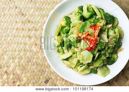 Stir Fried Broccoli (Pad Pak) Thai Traditional Food Hot And Spicy In White Plate On Wood Background