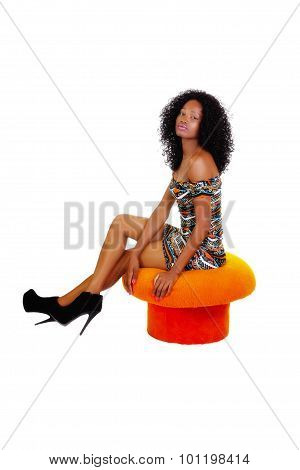 Skinny African American Woman Sitting Orange Stool