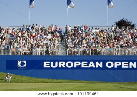 KENT ENGLAND, 31 MAY 2009. Christian CEVAER (FRA) lining up the winning putt to win the European Tour European Open golf tournament.