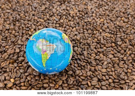 Many Whole Coffee Beans With South America On Globe