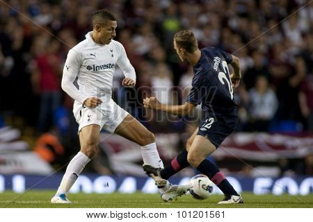 LONDON ENGLAND 25 August 2011.  Tottenham's Jake Livermore and Hearts player Gordon Smithin action during the UEFA Europa league match between Tottenham Hotspurs  and Hearts. Played at White Hart Lane