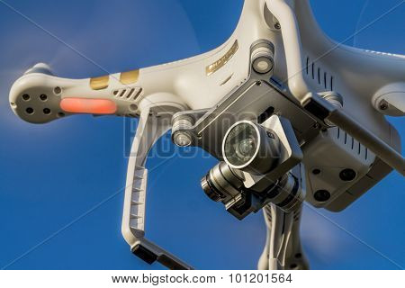 FORT COLLINS, CO, USA, SEPTEMBER 6,  2015:  Close up view of the DJI Phantom 3 quadcopter drone flying, focus on a gimbal and camera.