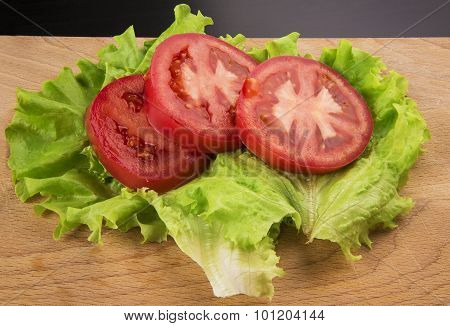 The Sliced Tomatoes On A Chopping Board