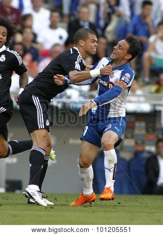 BARCELONA - MAY, 2015: Pepe(L) of Real Madrid fight with Sergio Garcia(R) Espanyol fight during a Spanish League match against RCD Espanyol at the Power8 stadium on Maig 17 2015 in Barcelona Spain