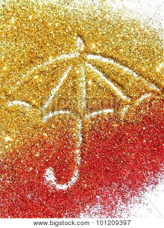 Blurry umbrella of golden and red glitter sparkle on white background