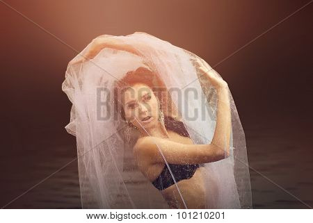 Mysterious and fashion portrait of sensual  female with veil covering the face