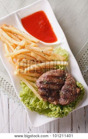 Fried Potatoes And Grilled Beefsteak Close-up On A Plate. Vertical Top View