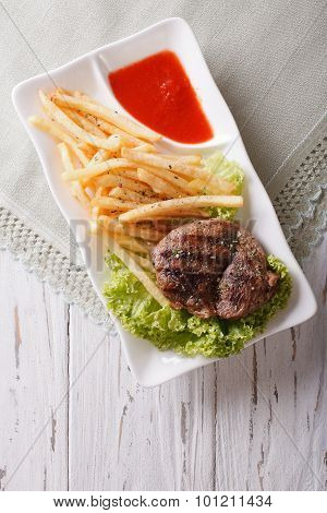 Fried Potatoes And Grilled Beefsteak With Ketchup. Vertical Top View