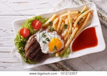 Beefsteak, Fried Egg And Potatoes On A Plate. Horizontal Top View