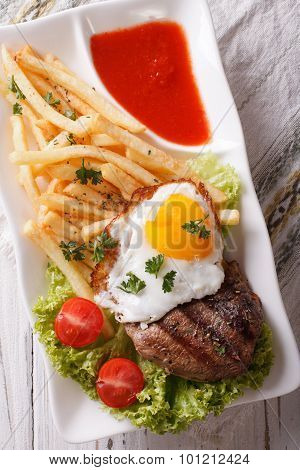 Beefsteak, Fried Egg And Potatoes On A Plate Closeup. Vertical Top View