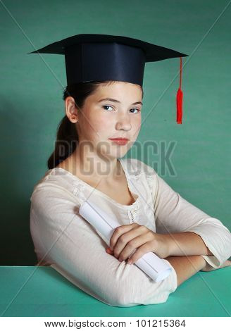 Girl In Graduating Cap Isolated On Blue