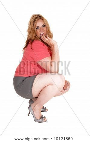 Plus Size Woman Crouching In Shorts And Heels.