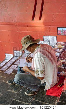 Asian Artist Working In His Street Art Studio-store