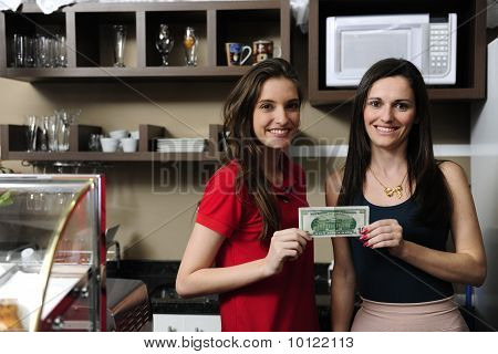 Small Business: Owners Of A Cafe Holding Cash