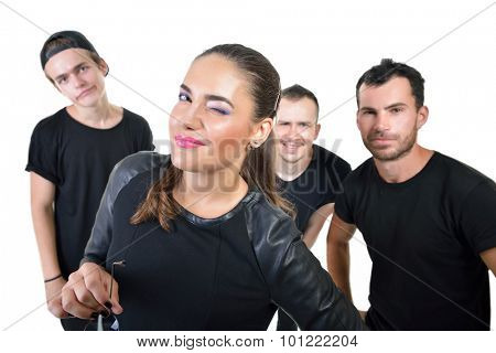 Music band studio portrait. Musicians robed in black posing in studio over white background, image toned and noise added.