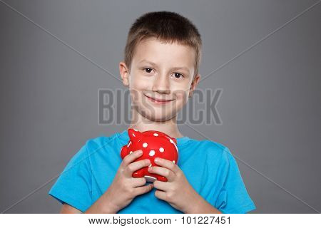Little Boy With Red Dotted Piggy Bank