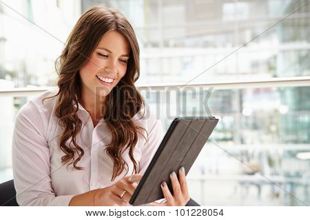 Young businesswoman using tablet computer, waist up
