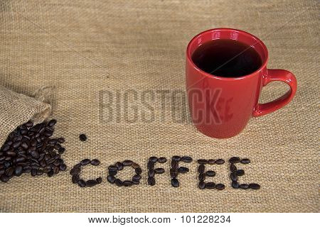raw coffee beans with red mug