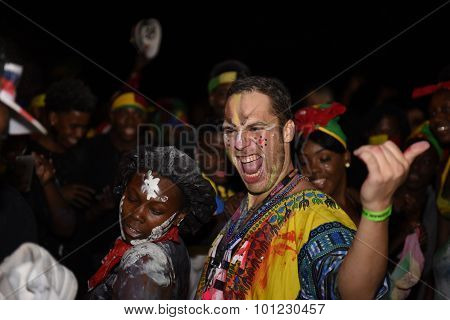 Revelers with painted faces