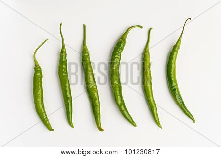 Green Chilli Peppers Ob White Background