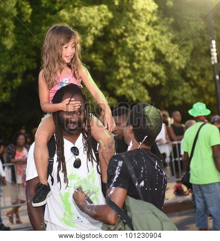 Girl gets ride on dad's shoulders