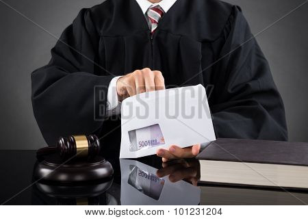 Judge Putting Money In Envelope