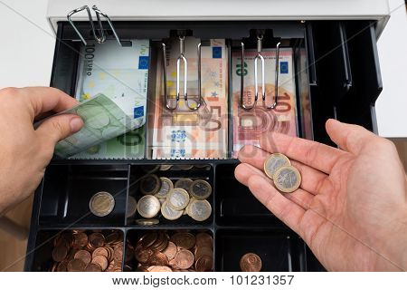 Person Hands With Money Over Cash Register
