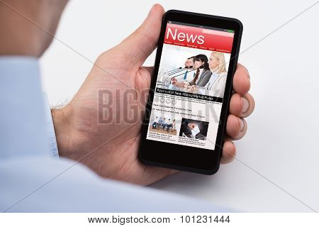 Businessperson Reading Online News