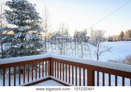 Backyard Deck In Winter Snow