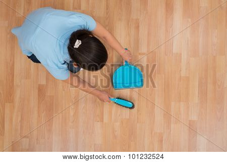 Woman Brooming Wooden Floor