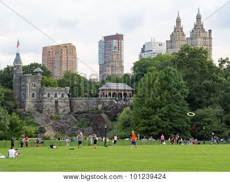 NEW YORK,USA - AUGUST 19,2015 : People at Central Park with a view of Belvedere Castle and the Central Park West skyline