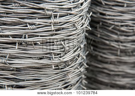 Barbed wire spools