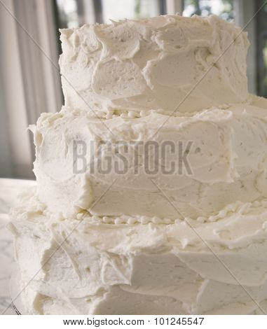 Blank white frosted wedding cake