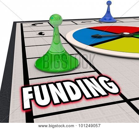 Funding word on a board game and a winning piece moving forward to secure financing for a business or company, with money and resources to support an operation