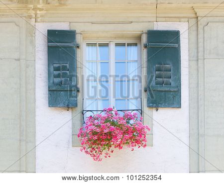 Old Window And Flowers At A Historic Building