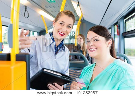 Inspector checking tickets in commuter bus