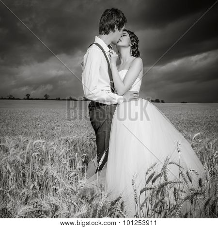 Young Married Couple In Wheat Field
